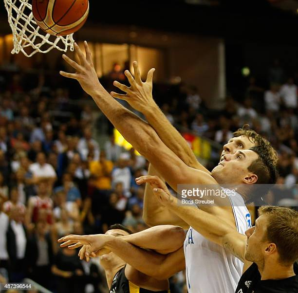 Danilo Gallinari of Italy drives to the basket against Dirk Nowitzki of Germany during the FIBA EuroBasket 2015 Group B basketball match between...