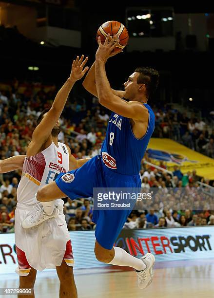 Danilo Gallinari of Italy drives to the basket against Felipe Reyes of Spain during the FIBA EuroBasket 2015 Group B basketball match between Spain...