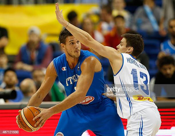 Danilo Gallinari of Italy drives to the basket against Hoerdur Vilhjalmsson of Iceland during the FIBA EuroBasket 2015 Group B basketball match...
