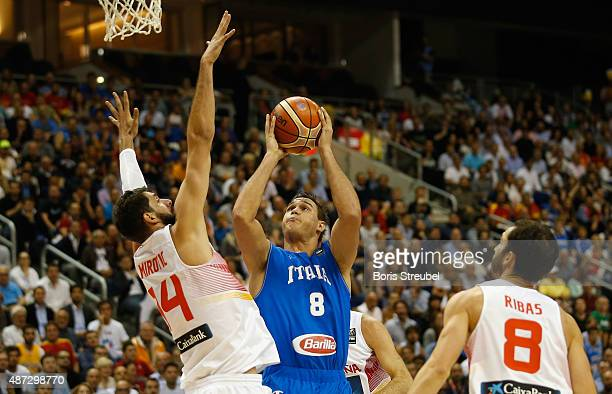 Danilo Gallinari of Italy drives to the basket against Nikola Mirotic of Spain during the FIBA EuroBasket 2015 Group B basketball match between Spain...