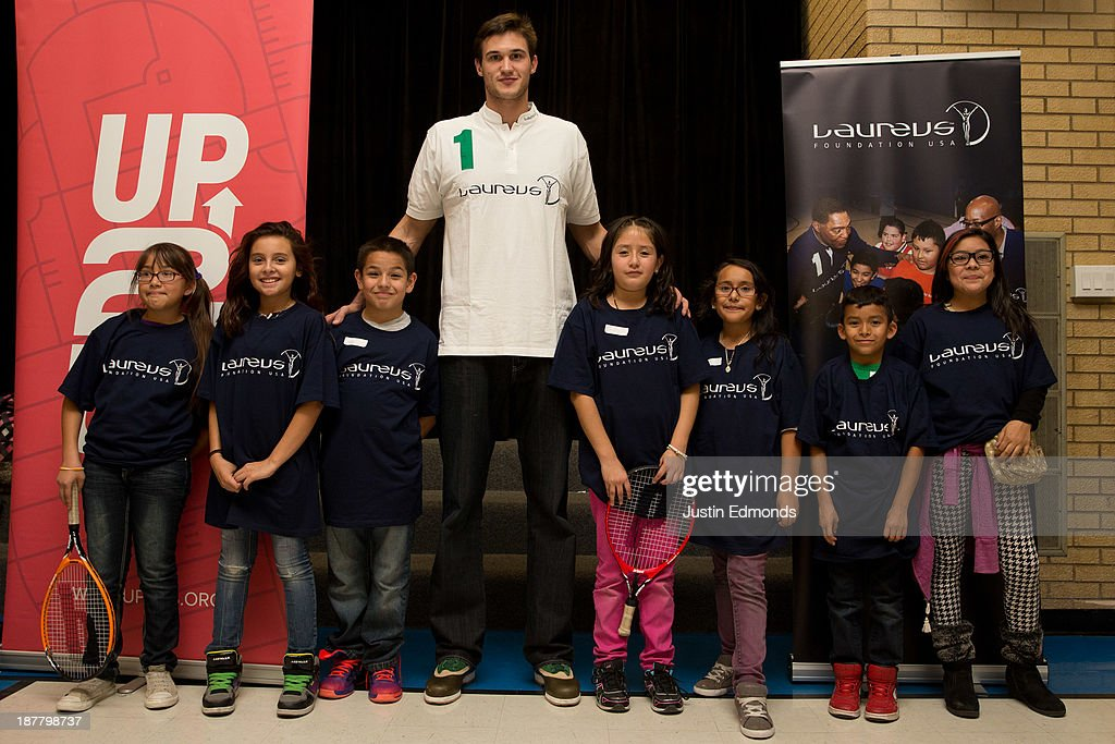 <a gi-track='captionPersonalityLinkClicked' href=/galleries/search?phrase=Danilo+Gallinari&family=editorial&specificpeople=4644476 ng-click='$event.stopPropagation()'>Danilo Gallinari</a> #8 of the Denver Nuggets, and Laureus ambassador, poses with kids during the Denver Project Launch to support Up2Us Coach Across America program at the Adams 50 USTA National Junior Tennis Learning Chapter inside Sunset Ridge Elementary School on November 12, 2013 in Westminster, Colorado.