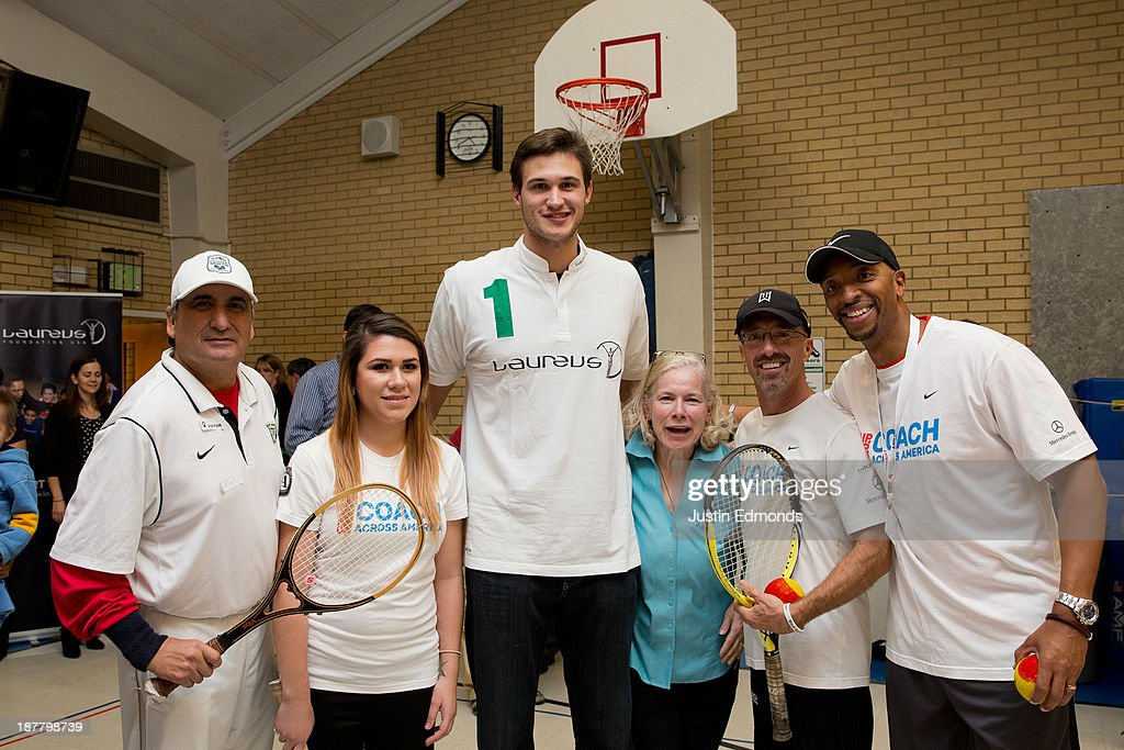 <a gi-track='captionPersonalityLinkClicked' href=/galleries/search?phrase=Danilo+Gallinari&family=editorial&specificpeople=4644476 ng-click='$event.stopPropagation()'>Danilo Gallinari</a> #8 of the Denver Nuggets, and Laureus ambassador, poses with coaches during the Denver Project Launch to support Up2Us Coach Across America program at the Adams 50 USTA National Junior Tennis Learning Chapter inside Sunset Ridge Elementary School on November 12, 2013 in Westminster, Colorado.