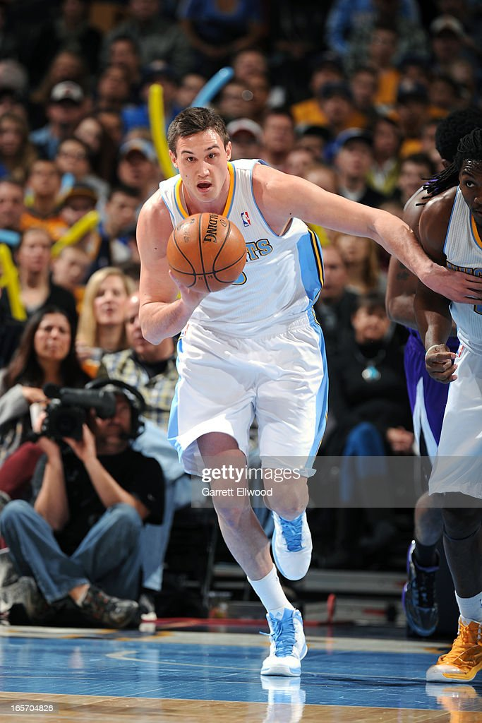 <a gi-track='captionPersonalityLinkClicked' href=/galleries/search?phrase=Danilo+Gallinari&family=editorial&specificpeople=4644476 ng-click='$event.stopPropagation()'>Danilo Gallinari</a> #8 of the Denver Nuggets brings the ball up court against the Sacramento Kings on March 23, 2012 at the Pepsi Center in Denver, Colorado.