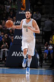 Danilo Gallinari of the Denver Nuggets brings the ball up court against the Los Angeles Lakers on April 8 2015 at the Pepsi Center in Denver Colorado...