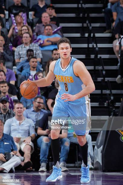 Danilo Gallinari of the Denver Nuggets brings the ball up the court against the Sacramento Kings on March 11 2017 at Golden 1 Center in Sacramento...