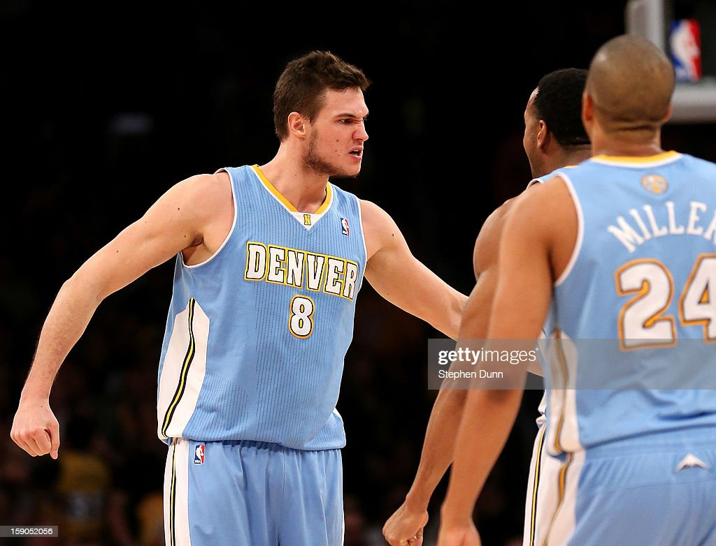 Danilo Gallinari #8 of the Denver Nuggets celebrates after making a three point shot with 13 seconds left in the game off a blocked shot to give the Nuggets a six point lead over the Los Angeles Lakers at Staples Center on January 6, 2013 in Los Angeles, California. The Nuggets won 112-105.