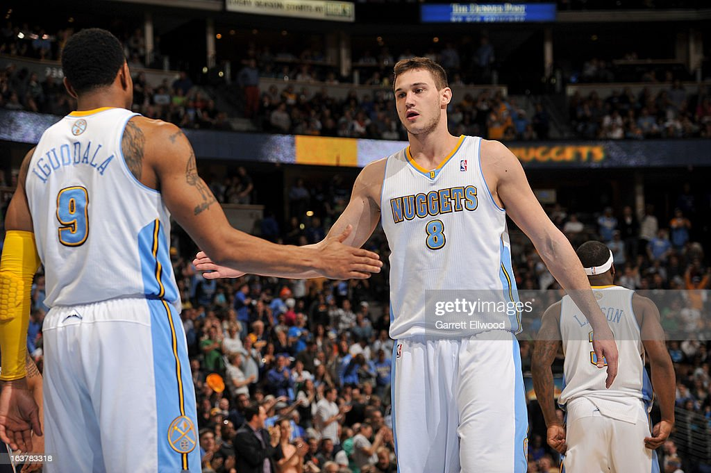 Danilo Gallinari #8 of the Denver Nuggets celebrates with teammate Andre Iguodala #9 during a game against the Memphis Grizzlies on March 15, 2013 at the Pepsi Center in Denver, Colorado.