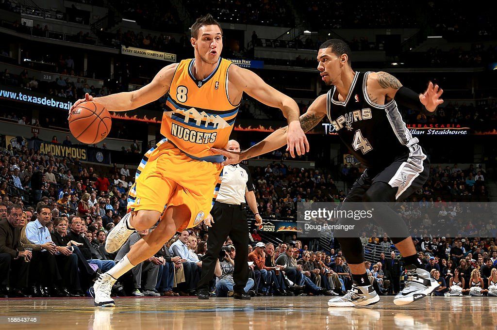 Danilo Gallinari #8 of the Denver Nuggets controls the ball against Danny Green #4 of the San Antonio Spurs at the Pepsi Center on December 18, 2012 in Denver, Colorado.