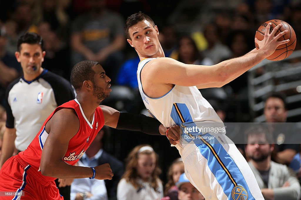 Danilo Gallinari #8 of the Denver Nuggets controls the ball against Chris Paul #3 of the Los Angeles Clippers at the Pepsi Center on March 7, 2013 in Denver, Colorado.