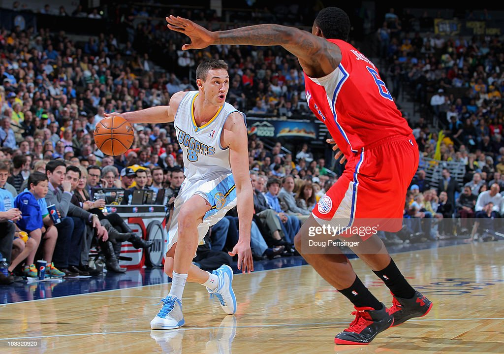 Danilo Gallinari #8 of the Denver Nuggets controls the ball against DeAndre Jordan #6 of the Los Angeles Clippers at the Pepsi Center on March 7, 2013 in Denver, Colorado. The Nuggets defeated the Clippers 107-92.