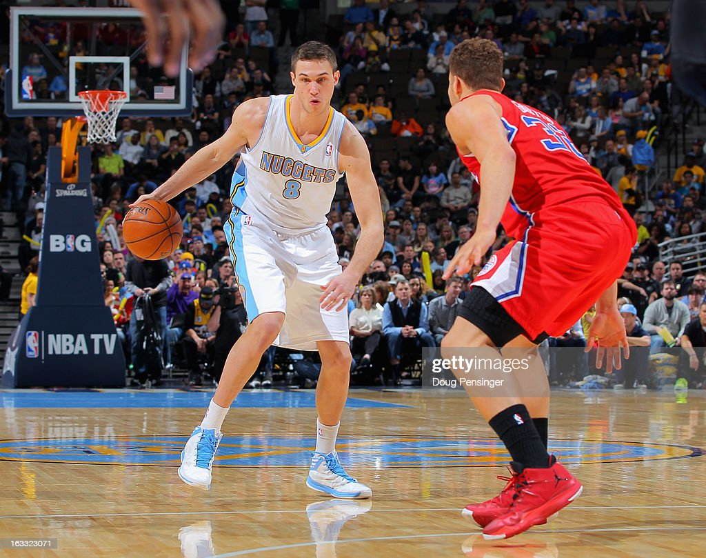 Danilo Gallinari #8 of the Denver Nuggets controls the ball against Blake Griffin #32 of the Los Angeles Clippers at the Pepsi Center on March 7, 2013 in Denver, Colorado. The Nuggets defeated the Clippers 107-92.