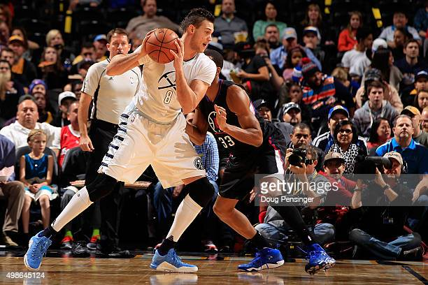 Danilo Gallinari of the Denver Nuggets controls the ball against Wesley Johnson of the Los Angeles Clippers at Pepsi Center on November 24 2015 in...