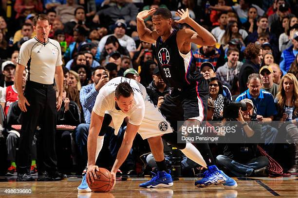 Danilo Gallinari of the Denver Nuggets controls the ball against the defense of Wesley Johnson of the Los Angeles Clippers at Pepsi Center on...