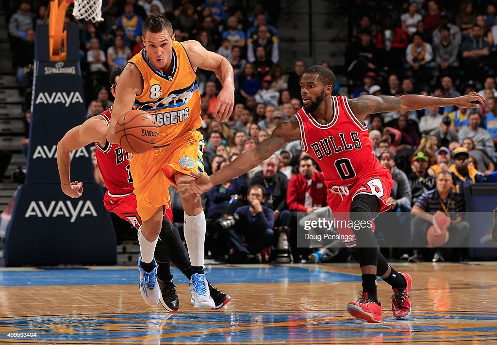 <a gi-track='captionPersonalityLinkClicked' href=/galleries/search?phrase=Danilo+Gallinari&family=editorial&specificpeople=4644476 ng-click='$event.stopPropagation()'>Danilo Gallinari</a> #8 of the Denver Nuggets controls the ball and heads down court against <a gi-track='captionPersonalityLinkClicked' href=/galleries/search?phrase=Aaron+Brooks+-+Basketball+Player&family=editorial&specificpeople=7133652 ng-click='$event.stopPropagation()'>Aaron Brooks</a> #0 of the Chicago Bulls at Pepsi Center on November 25, 2014 in Denver, Colorado. The Nuggets defeated the Bulls 114-109.