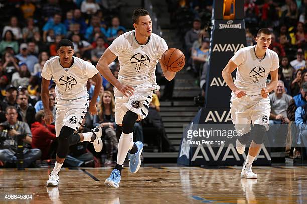 Danilo Gallinari of the Denver Nuggets controls the ball as he leads his teammates Gary Harris and Nikola Jokic of the Denver Nuggets up court...