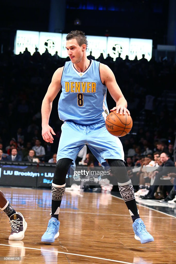 <a gi-track='captionPersonalityLinkClicked' href=/galleries/search?phrase=Danilo+Gallinari&family=editorial&specificpeople=4644476 ng-click='$event.stopPropagation()'>Danilo Gallinari</a> #8 of the Denver Nuggets defends the ball against the Brooklyn Nets during the game on February 8, 2016 at Barclays Center in Brooklyn, New York.