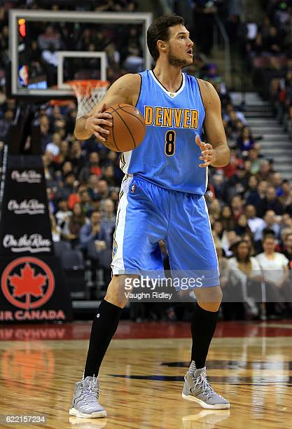 Danilo Gallinari of the Denver Nuggets dribbles the ball during the first half of an NBA game against the Toronto Raptors at Air Canada Centre on...