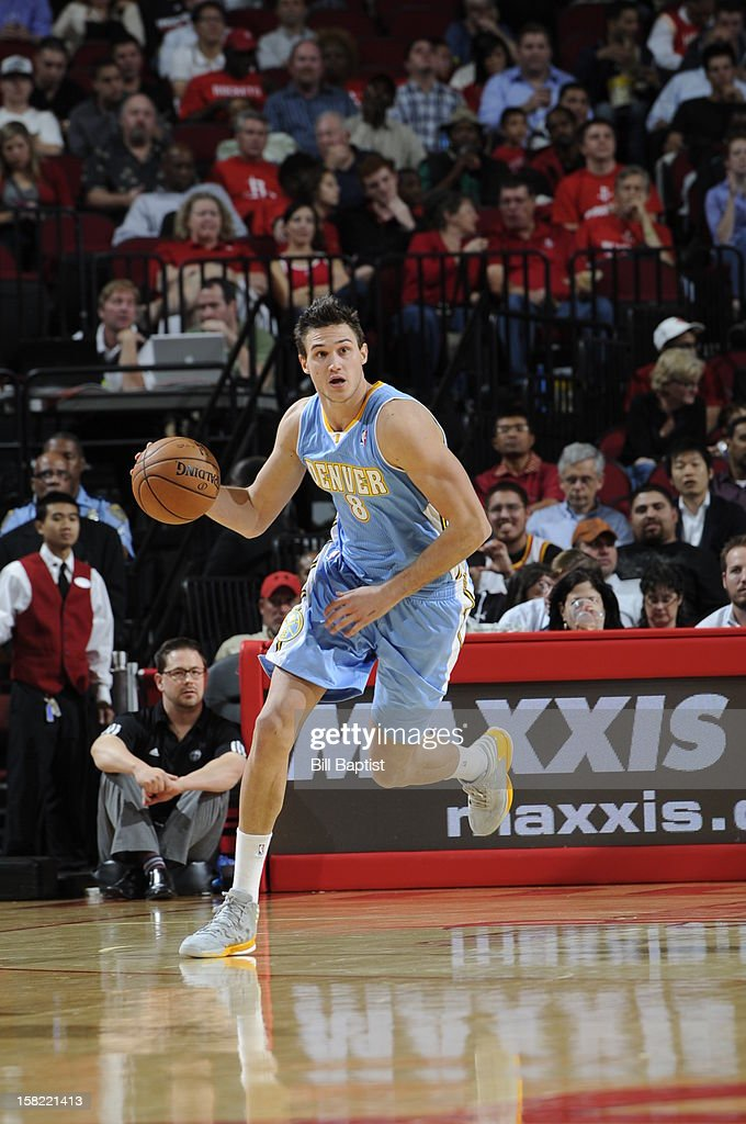 Danilo Gallinari #8 of the Denver Nuggets dribbles the ball up court against the Houston Rockets on November 7, 2012 at the Toyota Center in Houston, Texas.