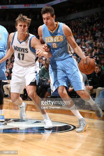 Danilo Gallinari of the Denver Nuggets drives against Andrei Kirilenko of the Minnesota Timberwolves during the game between the Minnesota...