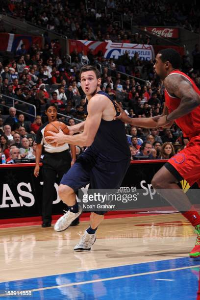 Danilo Gallinari of the Denver Nuggets drives against DeAndre Jordan of the Los Angeles Clippers dribbles during a Christmas Day game at Staples...