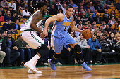 Danilo Gallinari of the Denver Nuggets drives against Jae Crowder of the Boston Celtics during the first quarter at TD Garden on January 27 2016 in...