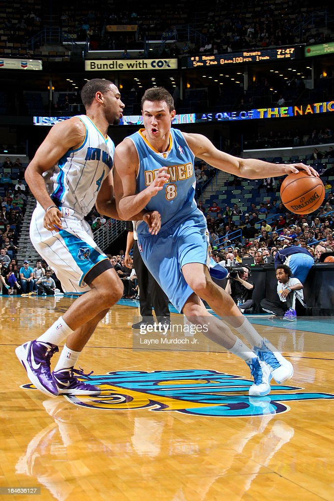 Danilo Gallinari #8 of the Denver Nuggets drives against Xavier Henry #4 of the New Orleans Hornets on March 25, 2013 at the New Orleans Arena in New Orleans, Louisiana.