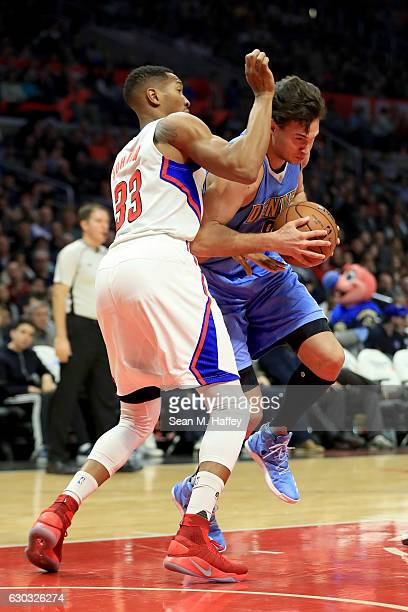 Danilo Gallinari of the Denver Nuggets drives past Wesley Johnson of the LA Clippers during the first half of a game at Staples Center on December 20...