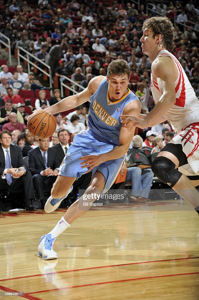 Danilo Gallinari #8 of the Denver Nuggets drives the ball against Omer Asik #3 of the Houston Rockets on January 23, 2013 at the Toyota Center in Houston, Texas.