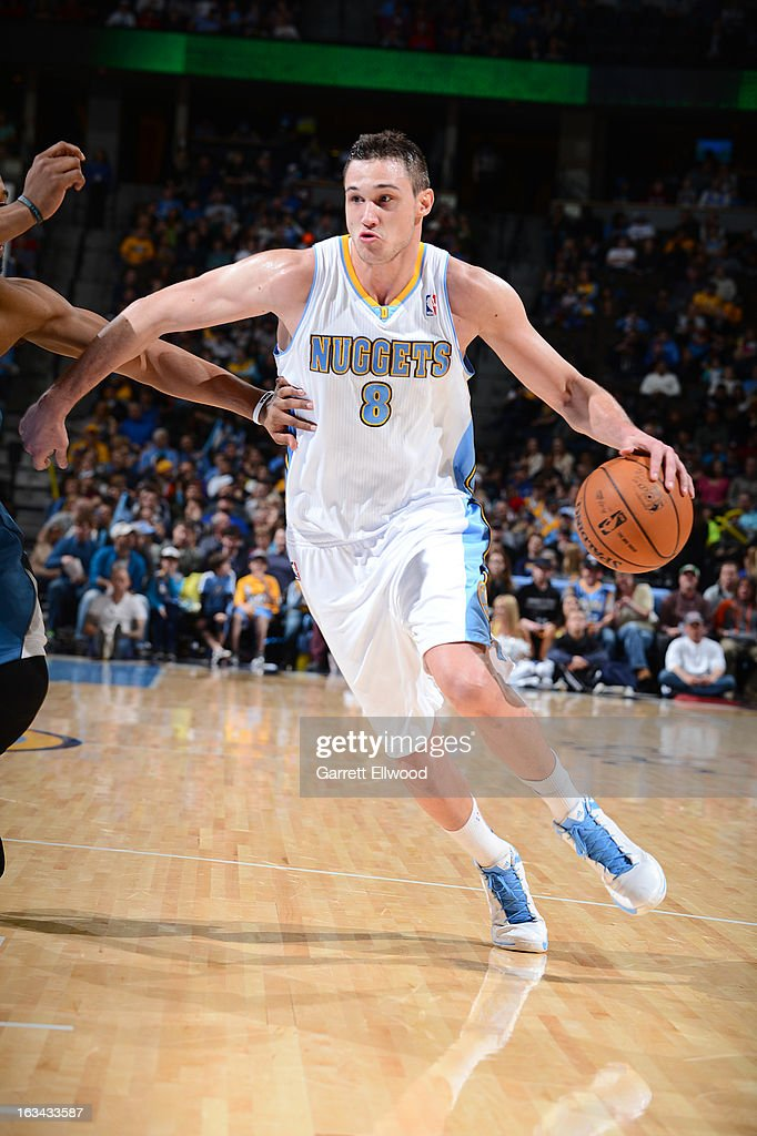 Danilo Gallinari #8 of the Denver Nuggets drives the ball during the game between the Minnesota Timberwolves and the Denver Nuggets on March 9, 2013 at the Pepsi Center in Denver, Colorado.