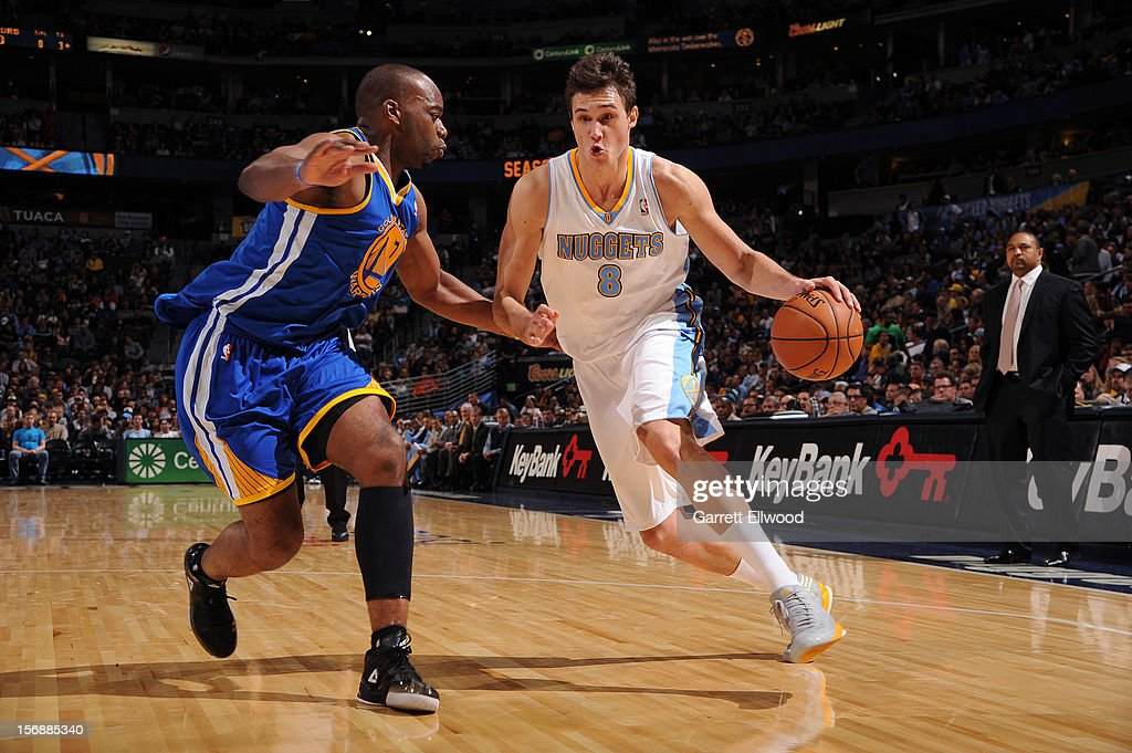 Danilo Gallinari #8 of the Denver Nuggets drives to the basket against Carl Landry #7 of the Golden State Warriors on November 23, 2012 at the Pepsi Center in Denver, Colorado.