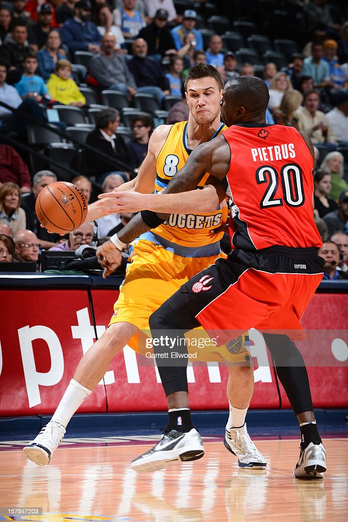 Danilo Gallinari #8 of the Denver Nuggets drives to the basket against Mickael Pietrus #20 of the Toronto Raptors on December 3, 2012 at the Pepsi Center in Denver, Colorado.