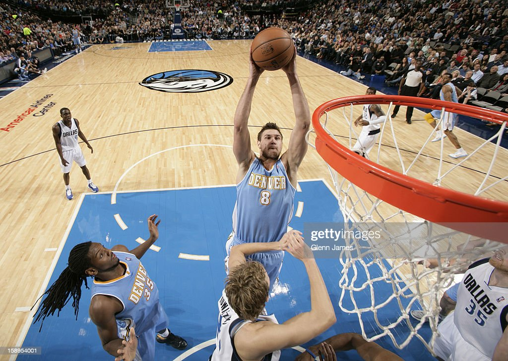 <a gi-track='captionPersonalityLinkClicked' href=/galleries/search?phrase=Danilo+Gallinari&family=editorial&specificpeople=4644476 ng-click='$event.stopPropagation()'>Danilo Gallinari</a> #8 of the Denver Nuggets drives to the basket against the Dallas Mavericks on December 28, 2012 at the American Airlines Center in Dallas, Texas.