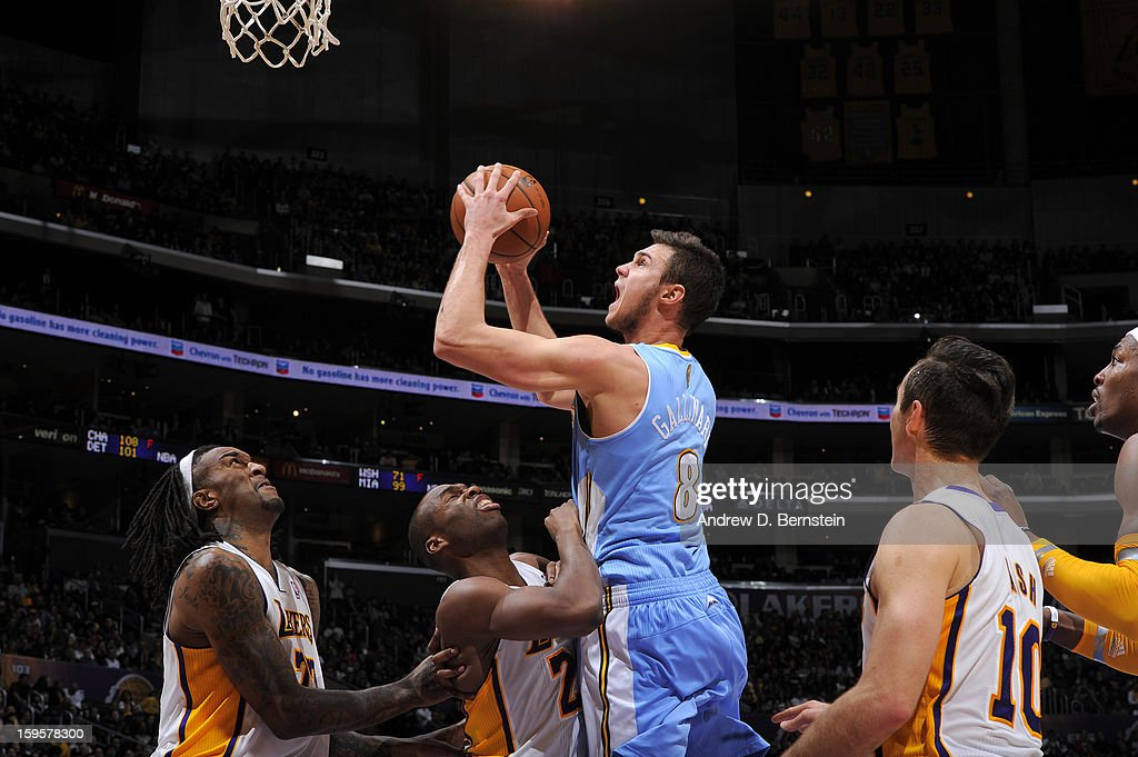 Danilo Gallinari #8 of the Denver Nuggets drives to the basket against the Los Angeles Lakers at Staples Center on January 6, 2013 in Los Angeles, California.