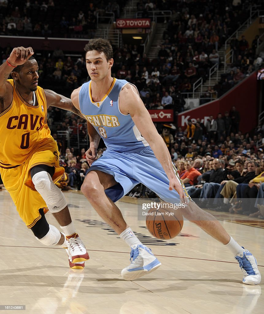 Danilo Gallinari #8 of the Denver Nuggets drives to the basket against C.J. Miles #0 of the Cleveland Cavaliers at The Quicken Loans Arena on February 9, 2013 in Cleveland, Ohio.