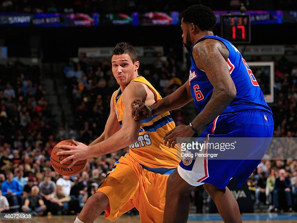 Danilo Gallinari of the Denver Nuggets drives to the basket against DeAndre Jordan of the Los Angeles Clippers at Pepsi Center on December 19 2014 in...