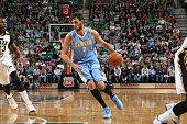 Danilo Gallinari of the Denver Nuggets drives to the basket against the Utah Jazz on April 1 2015 at EnergySolutions Arena in Salt Lake City Utah...