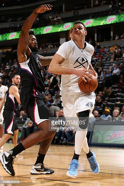 Danilo Gallinari of the Denver Nuggets drives to the basket against DeAndre Jordan of the Los Angeles Clippers at Pepsi Center on November 24 2015 in...