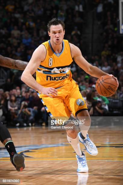 Danilo Gallinari of the Denver Nuggets drives to the basket against the Boston Celtics on March 10 2017 at the Pepsi Center in Denver Colorado NOTE...