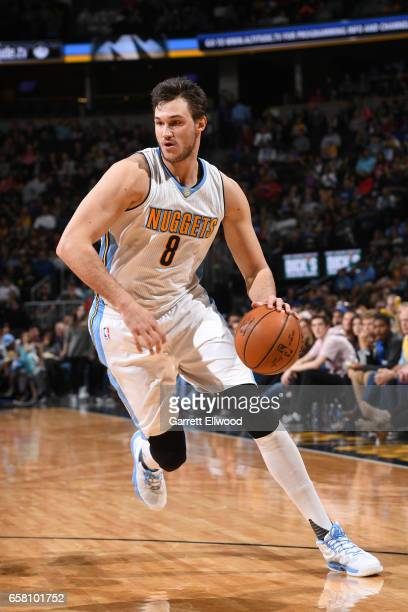 Danilo Gallinari of the Denver Nuggets drives to the basket against the New Orleans Pelicans on March 26 2017 at the Pepsi Center in Denver Colorado...