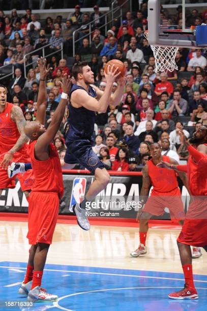 Danilo Gallinari of the Denver Nuggets drives to the basket ahead of Lamar Odom of the Los Angeles Clippers during a Christmas Day game at Staples...