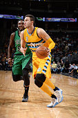 Danilo Gallinari of the Denver Nuggets drives to the basket during the game against the Boston Celtics on February 21 2016 at the Pepsi Center in...