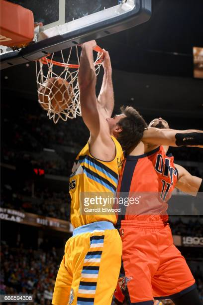 Danilo Gallinari of the Denver Nuggets dunks the ball against the Oklahoma City Thunder on April 9 2017 at the Pepsi Center in Denver Colorado NOTE...