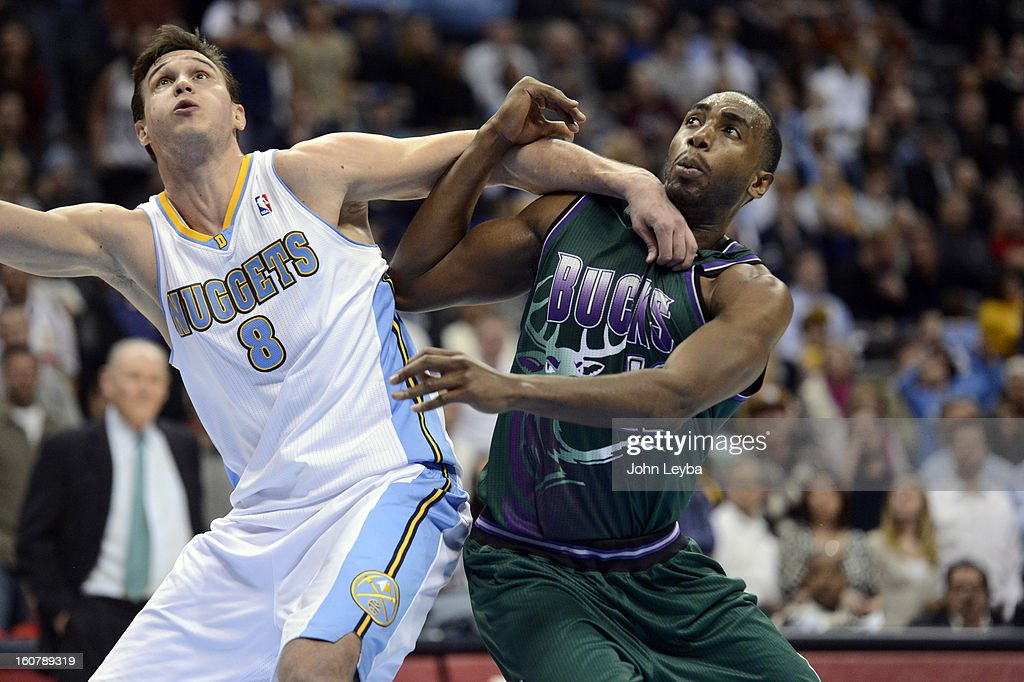 Danilo Gallinari (8) of the Denver Nuggets fights for position with Luc Richard Mbah a Moute (12) of the Milwaukee Bucks during the fourth quarter February 05, 2013 at Pepsi Center. The Denver Nuggets defeated the Milwaukee Bucks 112-104 in NBA action.