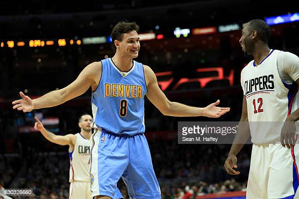 Danilo Gallinari of the Denver Nuggets gestures to Luc Mbah a Moute of the LA Clippers during the second half of a game at Staples Center on December...