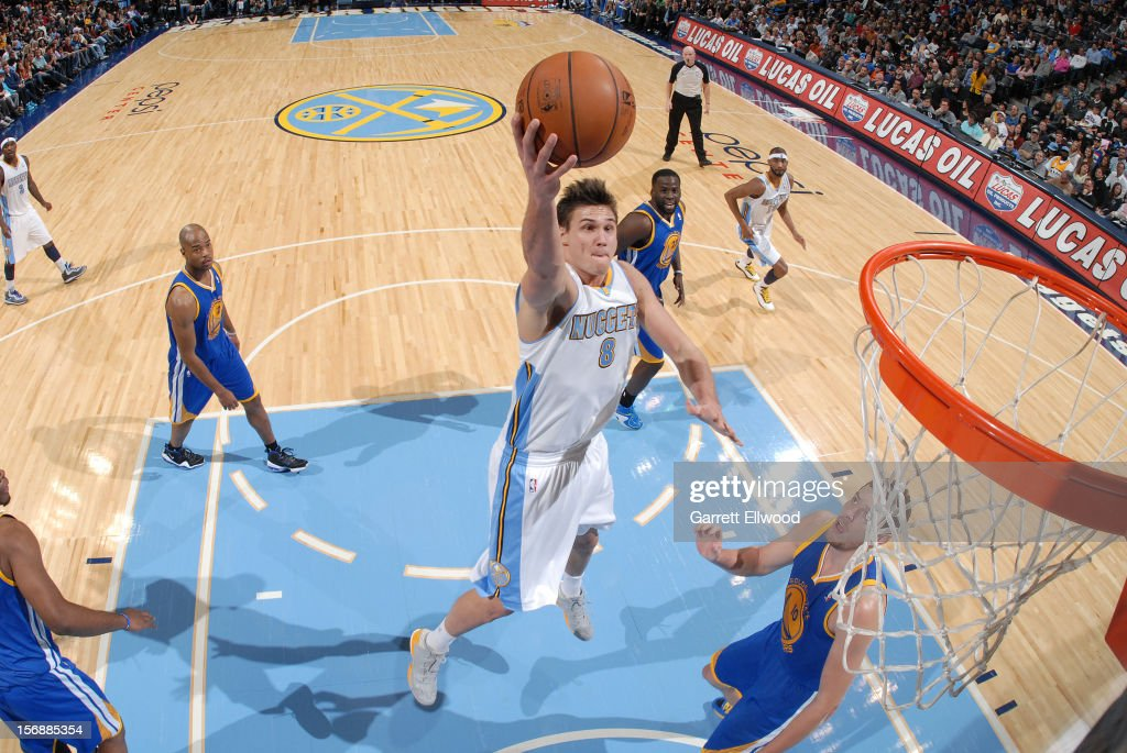 <a gi-track='captionPersonalityLinkClicked' href=/galleries/search?phrase=Danilo+Gallinari&family=editorial&specificpeople=4644476 ng-click='$event.stopPropagation()'>Danilo Gallinari</a> #8 of the Denver Nuggets goes to the basket against David Lee #10 of the Golden State Warriors on November 23, 2012 at the Pepsi Center in Denver, Colorado.