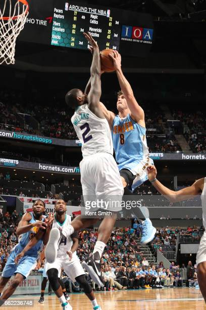 Danilo Gallinari of the Denver Nuggets goes to the basket against the Charlotte Hornets on March 31 2017 at Spectrum Center in Charlotte North...