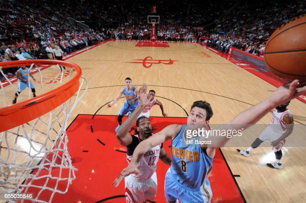 Danilo Gallinari of the Denver Nuggets goes to the basket against the Houston Rockets on April 5 2017 at the Toyota Center in Houston Texas NOTE TO...