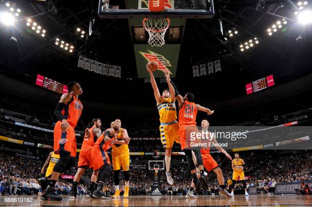 Danilo Gallinari of the Denver Nuggets goes to the basket against the Oklahoma City Thunder on April 9 2017 at the Pepsi Center in Denver Colorado...