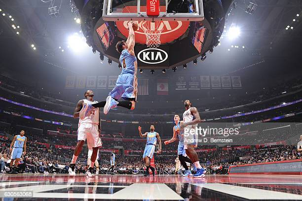 Danilo Gallinari of the Denver Nuggets goes up for a dunk during a game against the LA Clippers on December 26 2016 at the STAPLES Center in Los...