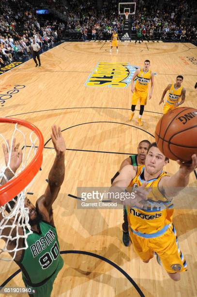 Danilo Gallinari of the Denver Nuggets goes up for a lay up against the Boston Celtics on March 10 2017 at the Pepsi Center in Denver Colorado NOTE...